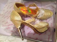 Beautiful, new, gold colour high heel sandals. Size 6. It has stones to beautify.