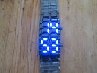 Striking and interesting blue LED Men's bracelet Watch. Must See.