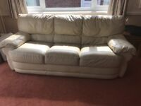 2 x 3 seater cream leather sofas - free if collected