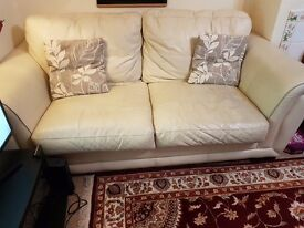 Real leather, ivory coloured sofas, 1 three seater and 1 single seater.