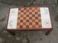 Chess table with tile inserts.
