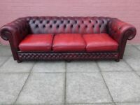 An Oxblood Red Leather 3/4 Seater Chesterfield Sofa