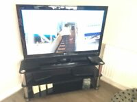 LG 42 inch tv and black glass stand