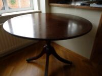 42 inch dia Pedestal Mahogany Table with four claw feet on castors.