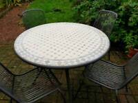Mosaic garden table and 4 matching metal chairs