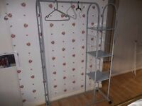 Clothes rail with shelves on wheels