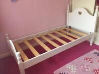 Solid white single bed
