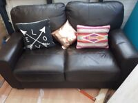 Two seater brown leather sofa 32 x 57 inches excellent condition