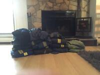 Selling 16 pairs of coveralls and other rig clothing