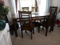Have for sale beautiful solid wood sheesham table and 6 chairs ..