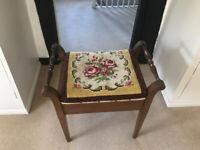 Mahogany piano stool with lift up storage seat.
