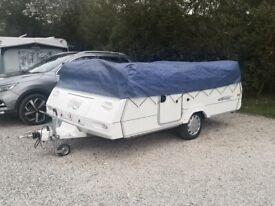 Folding camper.