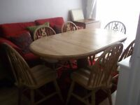 PINE TABLE & 6 WHEEL BACK CHAIRS