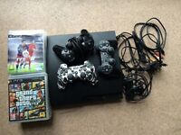 fully working ps3 with 3 controllers,12 games and a playstation camera