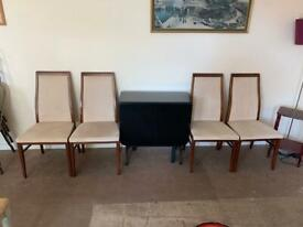 Black drop leaf table and G plan chairs