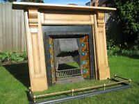 Antiques fireplace, pine mantle and surround with decorative tiles