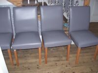 FOUR faux leather dining chairs - grey
