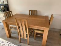 Oak 6-8 seat dining table with 6 chairs