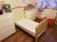 Cot bed. Converts to a junior bed