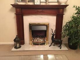Dark wood surround with marble fireplace.