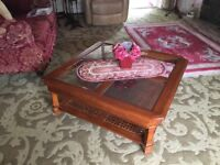 Beautiful wooden square coffee table with glass top