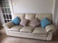 CREAM LEATHER THREE SEATER AND MATCHING ARM CHAIR IN VERY GOOD USED CONDITION FREE LOCAL DELIVERY