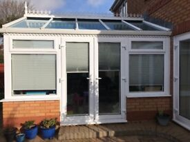 Conservatory with window blinds
