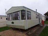 Static 6 berth 2 bed caravan for sale.