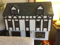 Handmade dolls house complete with exclusive furniture
