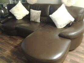 brown leather corner sofa with swivel end