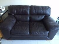 Real leather dark brown two and three seater sofas and pouf