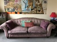Three-seater lilac velvet sofa
