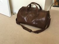 Brown leather travel hold-all