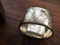 Vintage 1972 hallmarked silver heavy bangle, fully engraved. 60g weight.