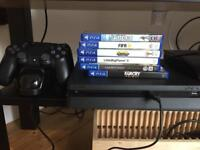 Practically new PS4, games, 2 controllers and extras