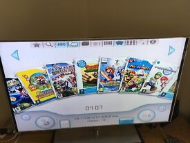 Nintendo Wii with 10 games