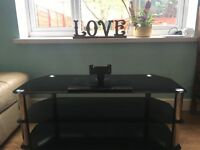 Black glass tv stand with attachment