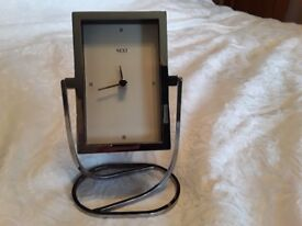 Next clock, stainless steel frame and stand, very good condition.