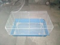 an indoor guinea pig/rabbit cage in good condition, clean and tidy.
