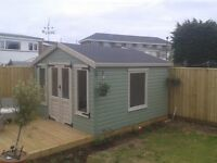 Summerhouse fencing decking and paving