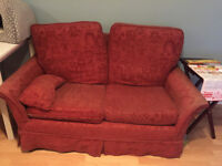 2 x two-seater matching red sofas