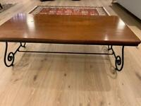 Rosewood coffee table with metal legs