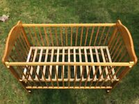Used baby cot ( Pinewood).
