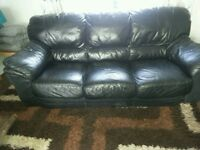 Real leather black three seater sofa good condition FREE
