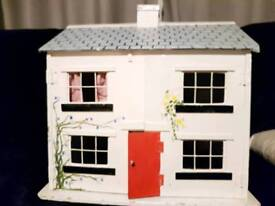 Dolls house 75years old with furniture