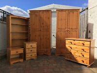 Pine bedroom furniture. Wardrobes, chest of drawers, bedside cabinets, bookcase.