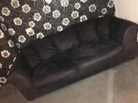 Large 2 seater and a large one seater black suede couch