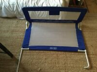 Useful blue Tomy bed guard/rail