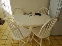 White circular kitchen table with 4 chairs