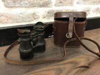 A pair of vintage binoculars with case
